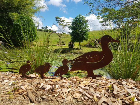 Mini Ducks following their mother duck. Metal garden artwork Broadcroft Design